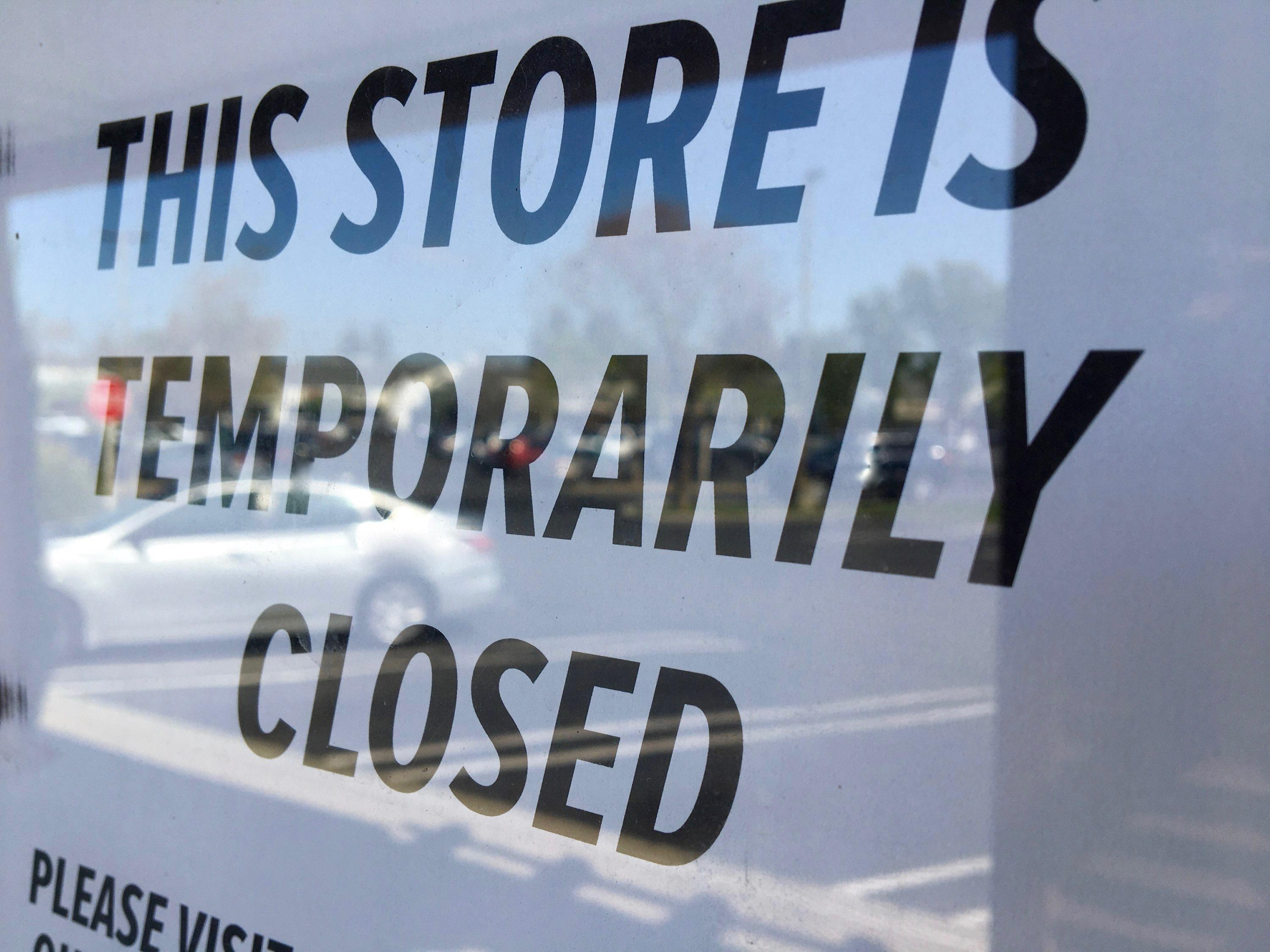 """A """"temporarily closed"""" sign on a Davis store"""