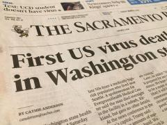 Front page of Sacramento Bee with COVID-19 headline